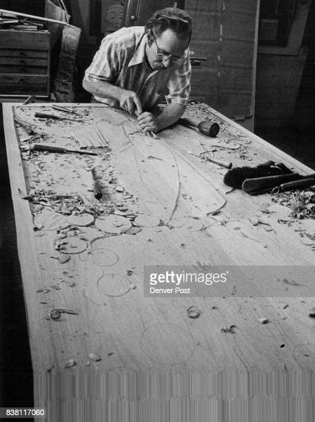 Aspenwall uses carving tool on Cherrywood door he is making for Lutheran Church of the Resurrection 7100 W Mississippi Ave Three doors will depict...