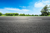 new asphalt road and green tree in countryside