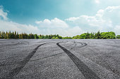 Asphalt road circuit and sky clouds with car tire brake,road landscape