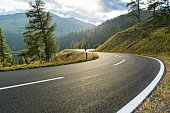 Asphalt road in Austria, Alps in a beautiful summer day, Hochalpenstrasse.