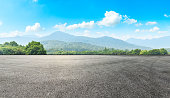Empty asphalt road pavement and green mountain