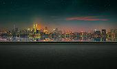Panoramic view of asphalt road side with beautiful Kuala Lumpur city waterfront skyline. Night scene .