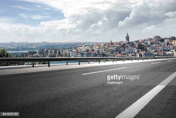 Asphalt road with Istanbul cityscape background.
