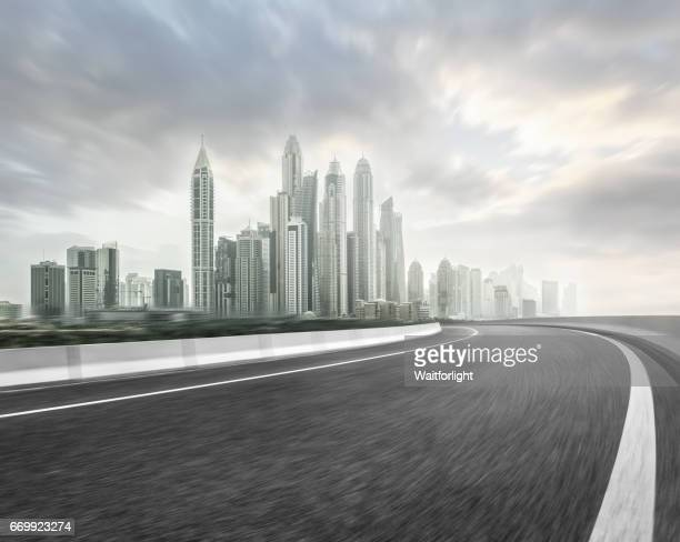 Asphalt road with modern skyscrapers background