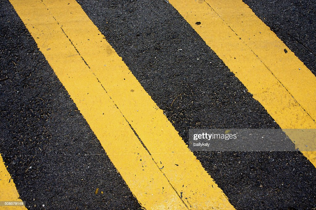 Asphaltic concrete road background and traffic sign : Stock Photo