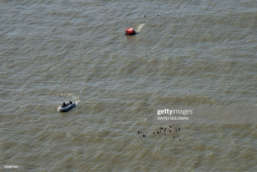 Aspirants to Air Force Academy and members of the Uruguayan Air Force Operations, Training and Rescue Unit take part in a drill at a beach of Salinas, near Montevideo, Uruguay on February 27, 2013. AFP PHOTO/Mario Goldman