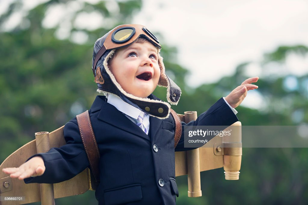 Aspiration, innovation business concept. Young child wearing hom : Stock Photo
