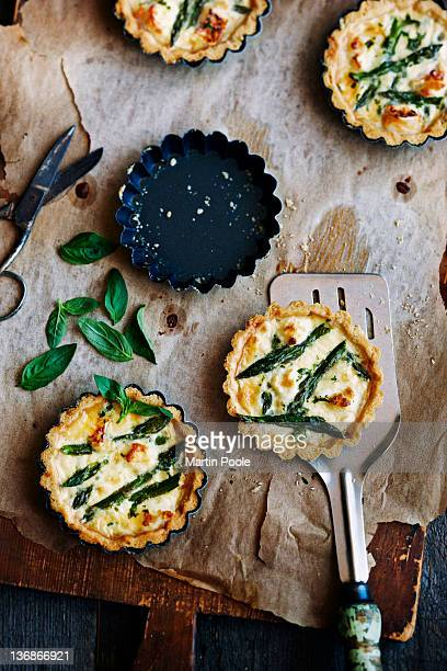 Aspragus and cheese tarts on board