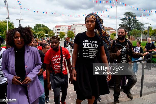 TOPSHOT Assa Traore the elder sister of late Adama Traore who died during his arrest by the police in July 2016 takes part in a commemorative march...