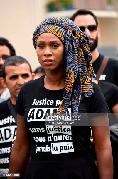 Assa Traore the elder sister of late Adama Traore who died during his arrest by the police in July 2016 wearing a teeshirt reading 'Justice for Adama...