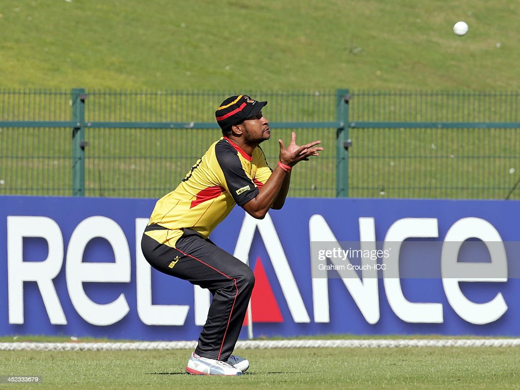 Assad Vala of PNG takes a catch to dismiss Tanwir Afzal of Hong Kong during the Quarter Final match 64 between Papua New Guinea and Hong Kong at the ICC World Twenty20 Qualifiers at the Zayed Cricket Stadium on November 28, 2013 in Abu Dhabi, United Arab Emirates.