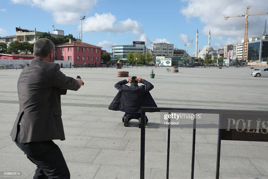 Assailant, 40-year-old Murat Sahin who attempted to shoot prominent Turkish journalist Can Dundar is caught by police outside a courthouse in Istanbul May 6, 2016, Turkey. Dundar, the editor-in-chief of the opposition Cumhuriyet newspaper, was unharmed but a reporter covering his trial appeared to have been injured. Dundar and Erdem Gul, the newspaper's Ankara bureau chief, could face life in jail on espionage charges and attempting to topple the government for publishing footage that purported to show Turkey's state intelligence agency ferrying weapons into Syria in 2014.