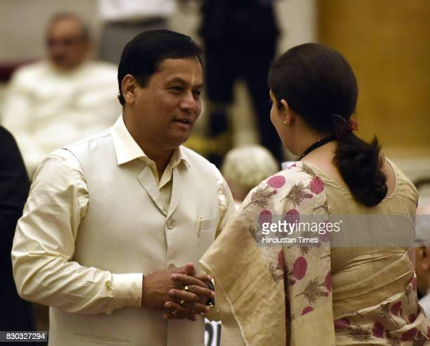 Assam Chief Minister Sarbananda Sonowal talking with Union Minister of Information and Broadcasting and Textiles Smriti Irani during the 13th...
