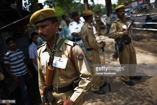 Assam Police officers stand guard near where to Indian Prime Minister Manmohan Singh voted at a polling station on April 23 2009 in Guwahati India...