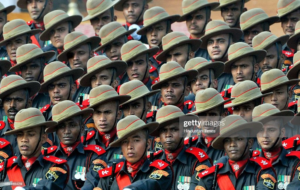 Assam Rifles jawans marching during the 65th Republic Day parade at Rajpath on January 26 2014 in New Delhi India India adopted its democratic...