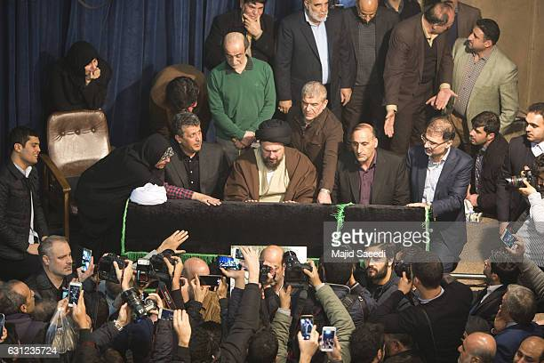 assan Khomeini center grandson of Iran's late revolutionary founder Ayatollah Khomeini mourns over the coffin of former President Akbar Hashemi...