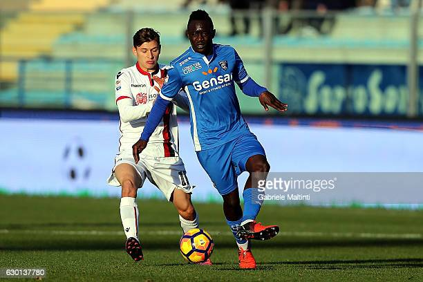 Assane Diousse' of Empoli FC battles for the ball with Nicolo' Barella of Cagliari Calcio during the Serie A match between Empoli FC and Cagliari...