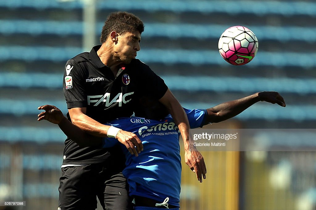 Assane Doiusse of Empoli FC battles for the ball with Adam Masina of Bologna Fc during the Serie A match between Empoli FC and Bologna FC at Stadio Carlo Castellani on May 1, 2016 in Empoli, Italy.