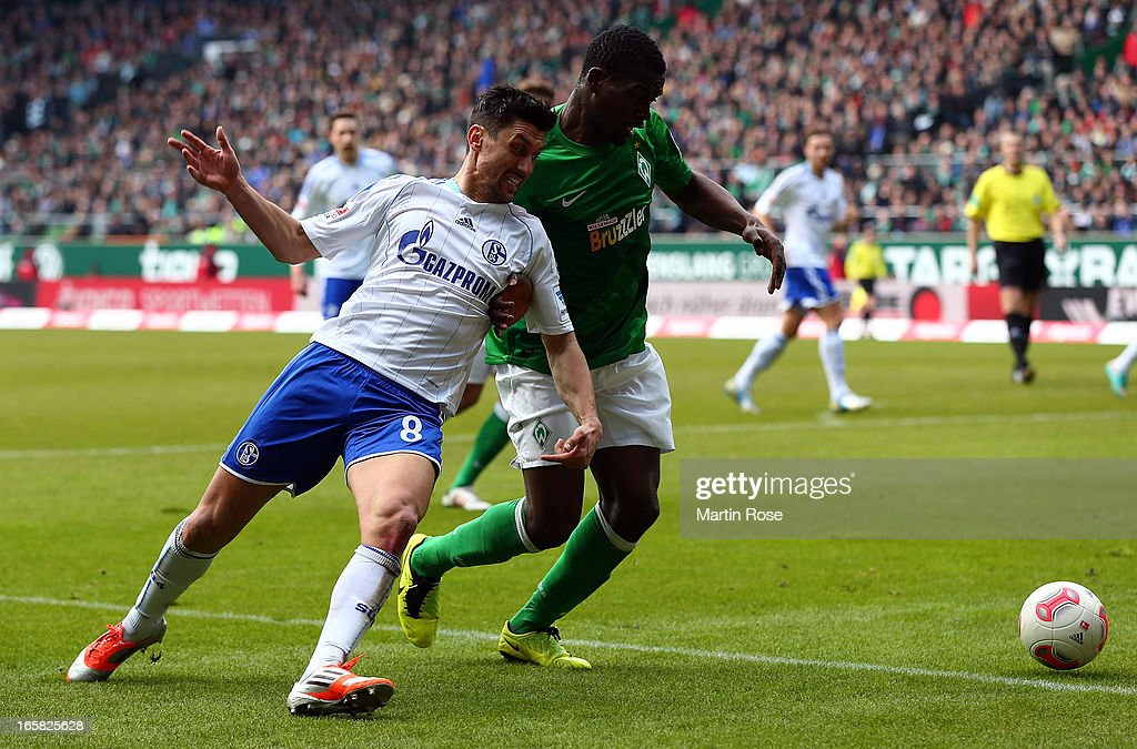 Assani Lukimya (R) of Bremen and Ciprian Marica (L) of Schalke battle for the ball during the Bundesliga match between Werder Bremen and FC Schalke 04 at Weser Stadium on April 6, 2013 in Bremen, Germany.