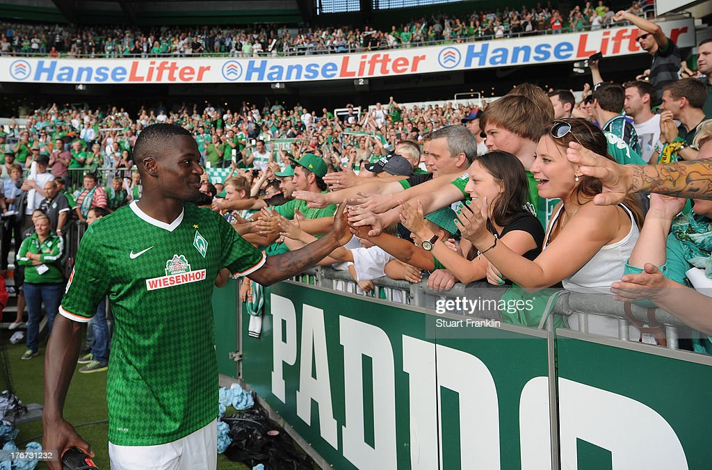 Assani Lukimya of Bremen celebrates with fans after the Bundesliga match between Werder Bremen and FC Augsburg at Weserstadion on August 17, 2013 in Bremen, Germany.
