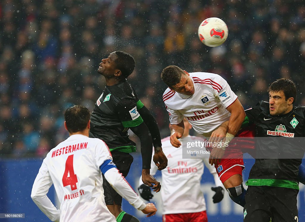 Assani Lukimya (C) of Bremen heads his team's 1st goal during the Bundesliga match between Hamburger SV and SV Werder Bremen at Imtech Arena on January 27, 2013 in Hamburg, Germany.