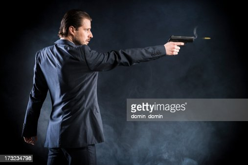 Assassin, gangster suit aiming with gun and fires, assassin, killer