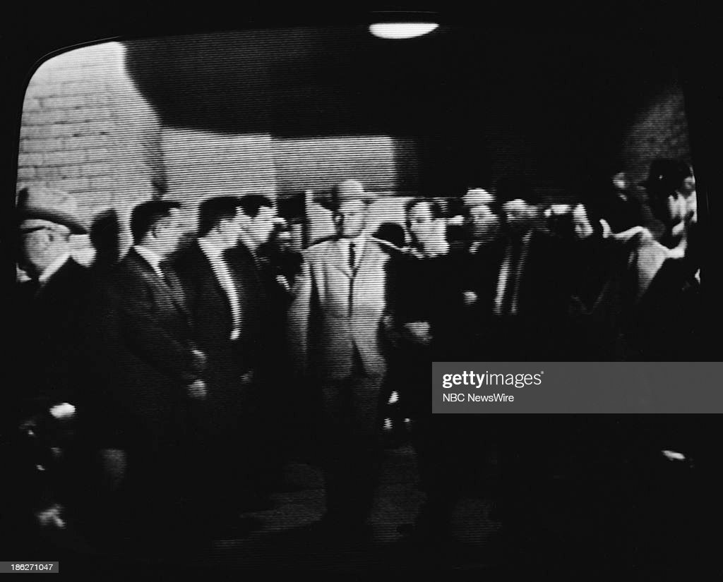REPORT -- 'Assassination of <a gi-track='captionPersonalityLinkClicked' href=/galleries/search?phrase=Lee+Harvey+Oswald&family=editorial&specificpeople=93679 ng-click='$event.stopPropagation()'>Lee Harvey Oswald</a>' -- Pictured: (l-r) Dallas homicide detective Jim Leavelle, John F. Kennedy's assassin <a gi-track='captionPersonalityLinkClicked' href=/galleries/search?phrase=Lee+Harvey+Oswald&family=editorial&specificpeople=93679 ng-click='$event.stopPropagation()'>Lee Harvey Oswald</a> moments before Oswald was shot by Jack Ruby on November 24, 1963 at the Dallas Police Headquarters in Dallas, Texas --