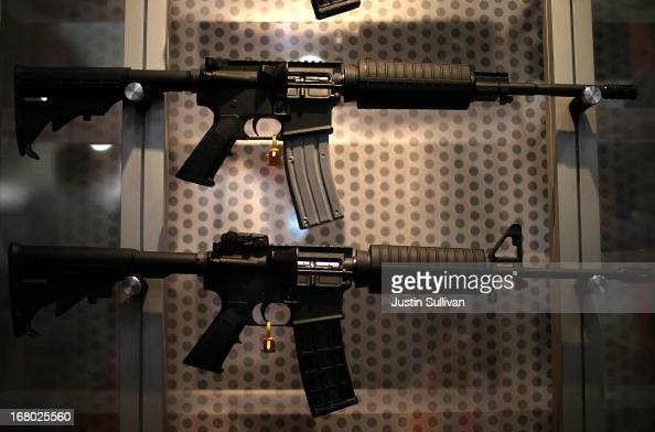 Assault rifles are displayed during the 2013 NRA Annual Meeting and Exhibits at the George R Brown Convention Center on May 4 2013 in Houston Texas...