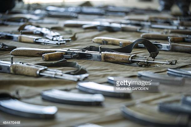 Assault rifles are displayed on September 1 2014 at the Makoanyane Barracks in Maseru during a press conference to present 130 firearms and a number...