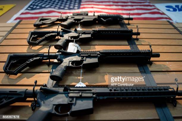 Assault rifles hang on the wall for sale at Blue Ridge Arsenal in Chantilly Virginia on October 6 2017 / AFP PHOTO / JIM WATSON
