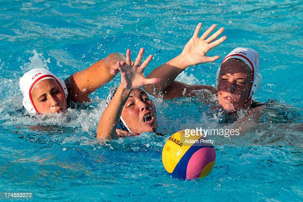 Assel Jakayeva of Kazakhstan chases the ball down during the Women's Water Polo quarter final qualification match between Canada and Kazakhstan...