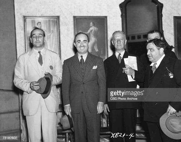 Assembled in a replica barbershop in Central Park for an amateur barbershop quartet singing contest are from left American public official and city...