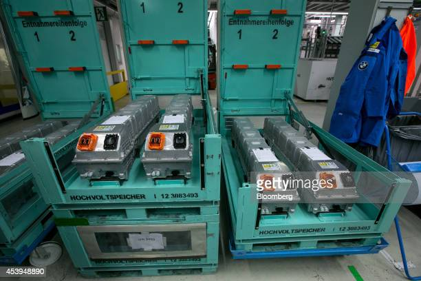 Assembled lithiumion batteries sit in crates at the Bayerische Motoren Werke AG automobile manufacturing plant in Dingolfing Germany on Thursday Aug...