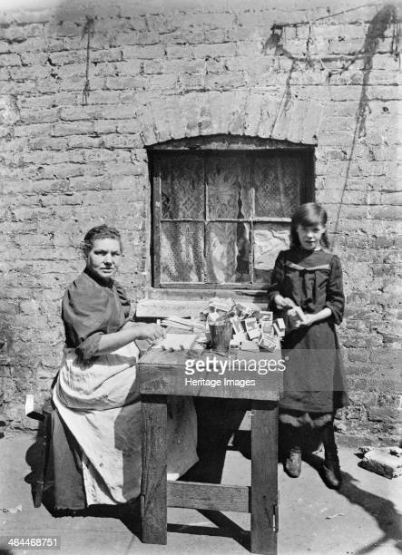 Assembling match boxes at home 1900s A woman and young girl working at a table outside their house Galt came to London in 1890 to work as a...