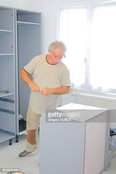 Assembling new kitchen furniture