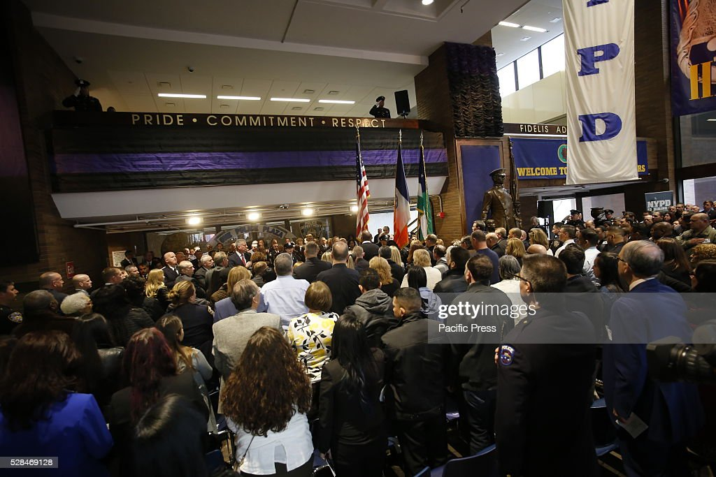 Assembly at One Police Plaza stand for Pledge of Allegiance prior to unveiling. NYC mayor Bill de Blasio & NYPD commissioner William Bratton presided over a solemn annual ceremony at One Police Plaza adding names to the NYPD's Memorial Wall of officers who have died in the line of duty or in duty-related circumstances.