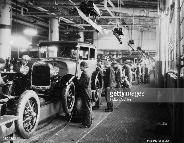 Assembly line workers inside the Ford Motor Company factory at Dearborn Michigan