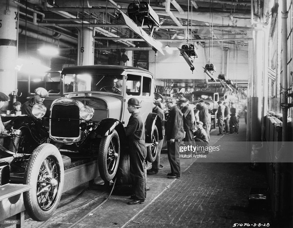 Assembly line workers inside the Ford Motor Company factory at Dearborn Michigan & Ford Motor Company Stock Photos and Pictures | Getty Images markmcfarlin.com