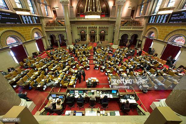 Assembly members sit inside the State Capitol building in Albany New York US on Wednesday March 19 2014 Budget talks among New York Governor Andrew...
