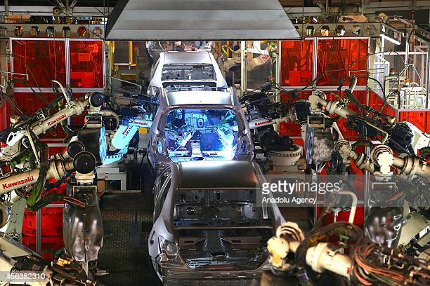 Assembly robots weld together stamped out metal parts at the Toyota Motor Manufacturing Turkey's assembly plant in Sakarya Turkey on September 30...