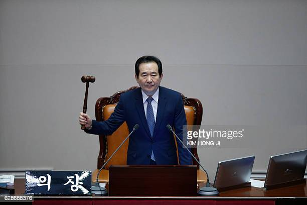 TOPSHOT Assembly Speaker Chung Syekyun presides over a plenary session to vote on the impeachment bill of South Korean President Park Geunhye at the...