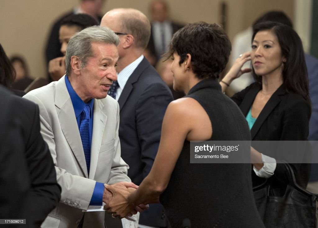 Assemblyman Tom Ammiano (D-San Francisco) greets actress Halle Berry at the Capitol on Tuesday, June 25, 2013, in Sacrameto, California, following Berry's testimony before the Assembly Committee on Public Safety regarding Senate bill SB 660, which would restrict paparazzi from harassing people. The committee voted in favor of the bill, despite opposition from advocates who warned it could hamper news-gathering operations.