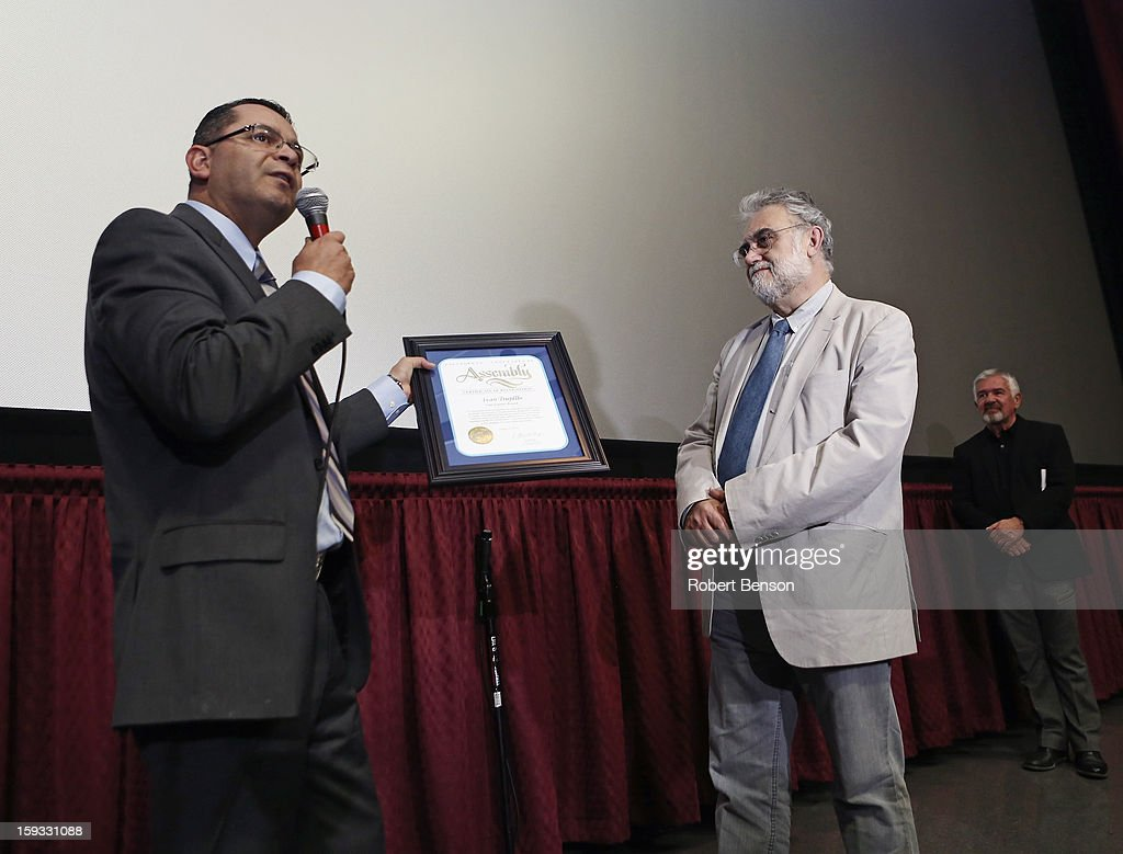 Assemblymember V. Manual Perez (L) honors Latin American filmmaker Ivan Trujillo at a proclamation event where Trujillo was honored for his film accomplishments at the 24th Annual Palm Springs International Film Festival on January 11, 2013 in Palm Springs, California.