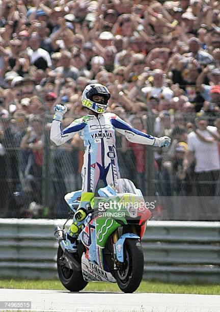 Italy's Valentino Rossi jubilates after winning the Dutch Grand Prix in Assen 30 June 2007 Seventime world champion Rossi riding a Yamaha won the...