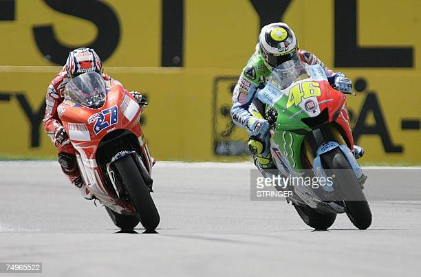 Italy's Valentino Rossi passes Australian Casey Stoner in the third last round during the 125cc race of the Dutch Grand Prix in Assen 30 June 2007...