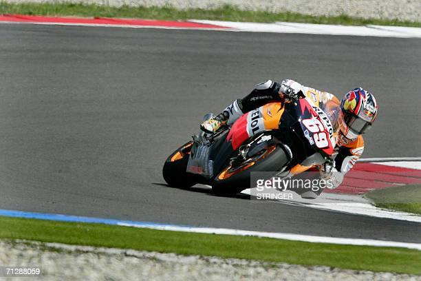 US rider Nicky Hayden competes in the Dutch MotoGP in Assen 24 June 2006 Hayden snatched victory from compatriot Colin Edwards on the last bend in...