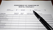 Someone filling out Assessment of Condition of Rental Property.
