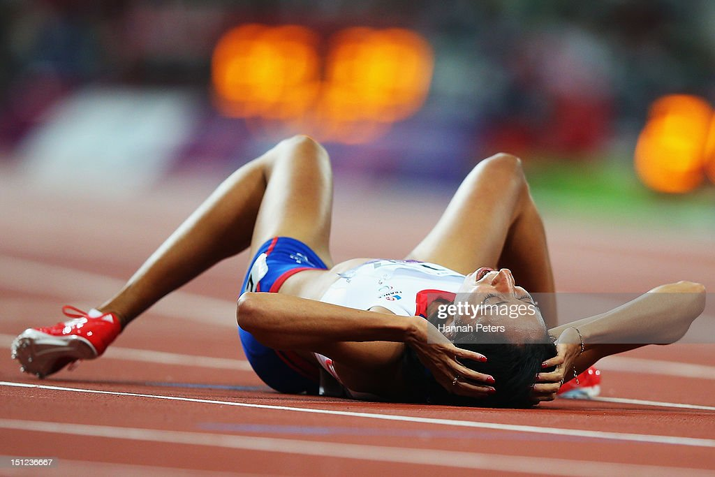 <a gi-track='captionPersonalityLinkClicked' href=/galleries/search?phrase=Assia+El+Hannouni&family=editorial&specificpeople=2905697 ng-click='$event.stopPropagation()'>Assia El Hannouni</a> of France celebrates winning the Women's 400m ¿ T12 final on day 6 of the London 2012 Paralympic Games at Olympic Stadium on September 4, 2012 in London, England.