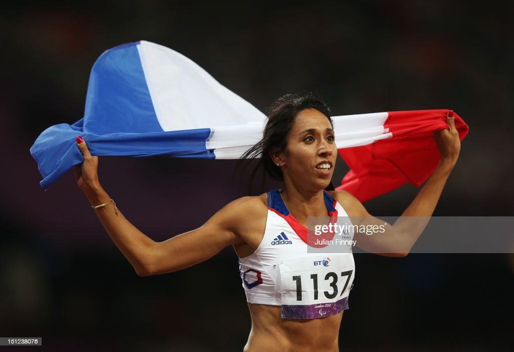 <a gi-track='captionPersonalityLinkClicked' href=/galleries/search?phrase=Assia+El+Hannouni&family=editorial&specificpeople=2905697 ng-click='$event.stopPropagation()'>Assia El Hannouni</a> of France wins gold in the Women's 400m - T12 Final on day 6 of the London 2012 Paralympic Games at Olympic Stadium on September 4, 2012 in London, England.