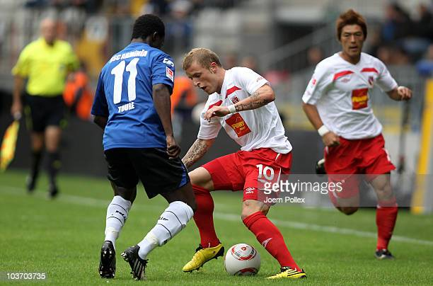 Assimiou Toure of Bielefeld and Daniel Adlung of Cottbus battle for the ball during the Second Bundesliga match between Arminia Bielefeld and Energie...